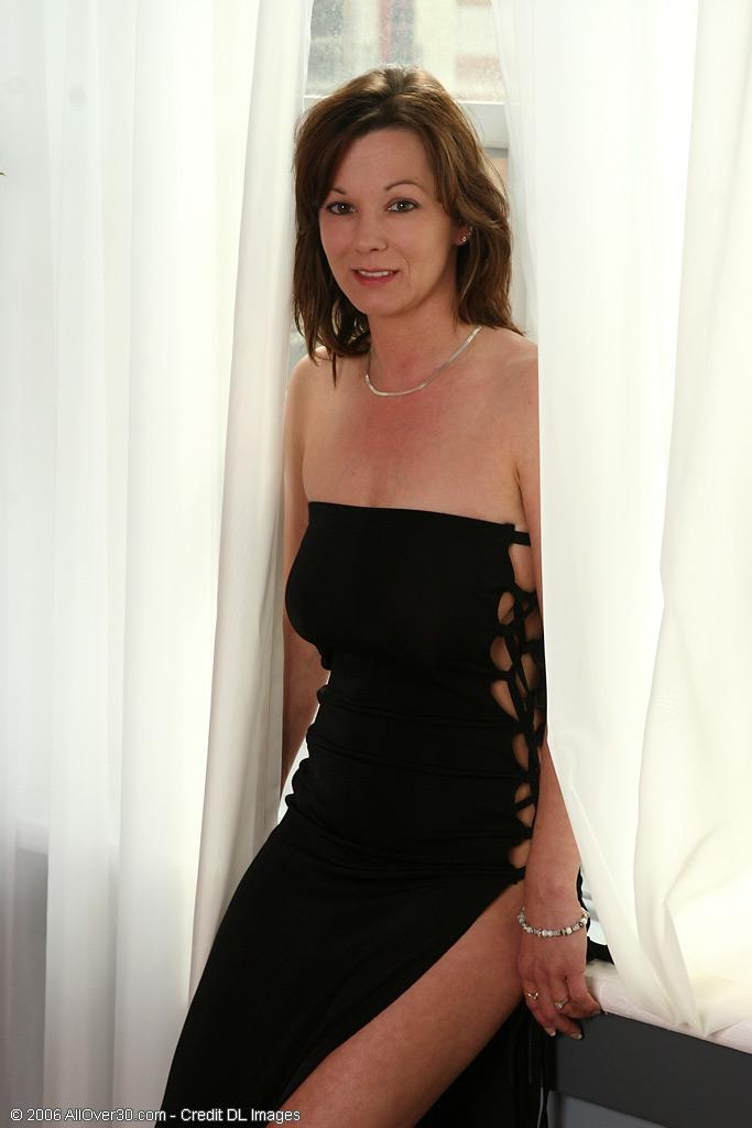 Elegant Samantha Playfully Posing in a Ebony Dress