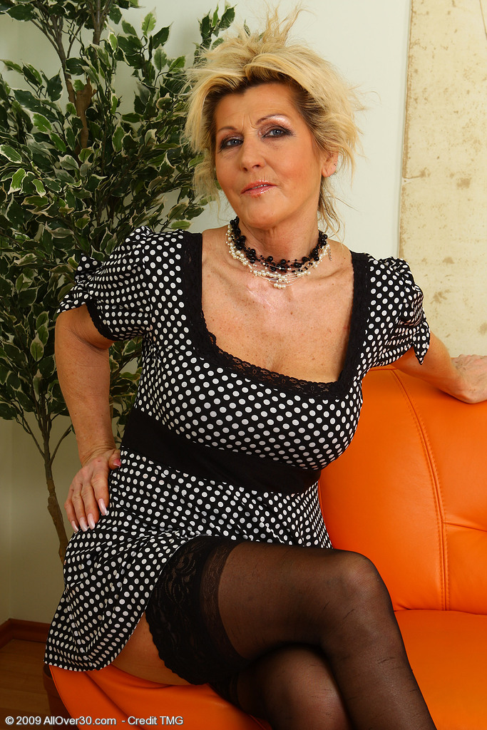 Berna Glides a Pinkish Dildo into Her 52 Year Old Hot and  Wooly  Vulva