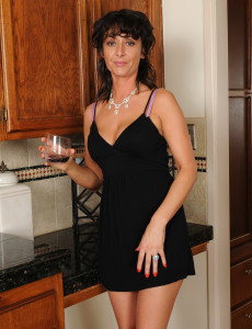 Elegant  Brown Haired Coral Showcasing off Her Tight  Older Body in Here