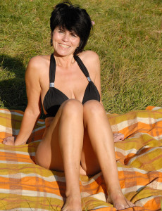 Brown Haired Milf Eve  Opens Her 46 Year Old  Twat out in the Park