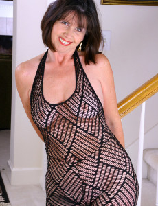 Knockout  Older Babe  Brown Haired in a Hot Ebony Bodystocking Posing Pear Gag