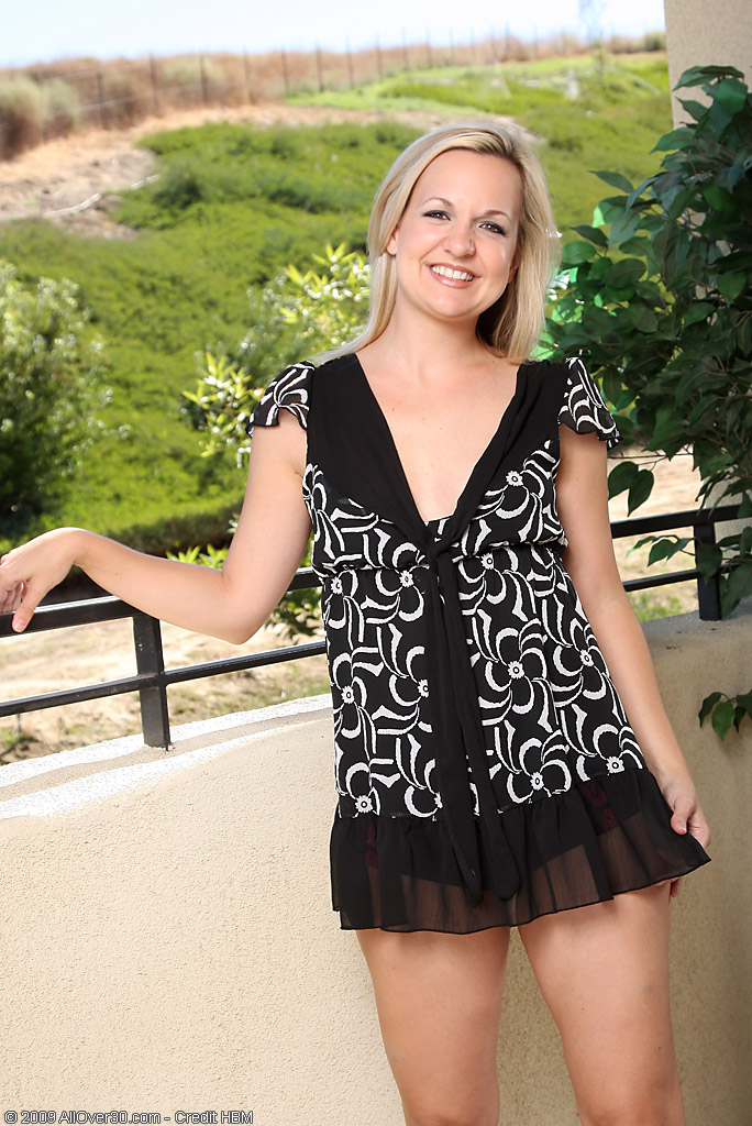 Blond Haired  Cougar Hanna S from  Milfs30 Taunts Us on the Balcony