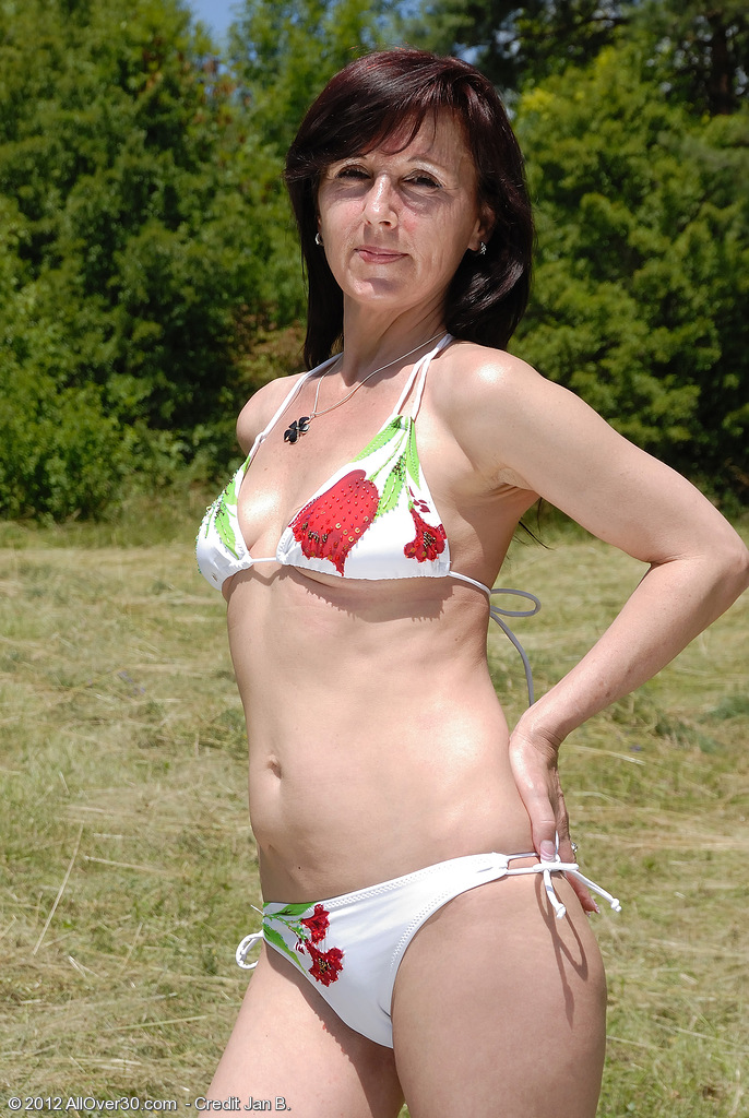 46 Year Old Jenny H Rips off Her Swimsuit and  Opens Her  Older Stunner  Rump
