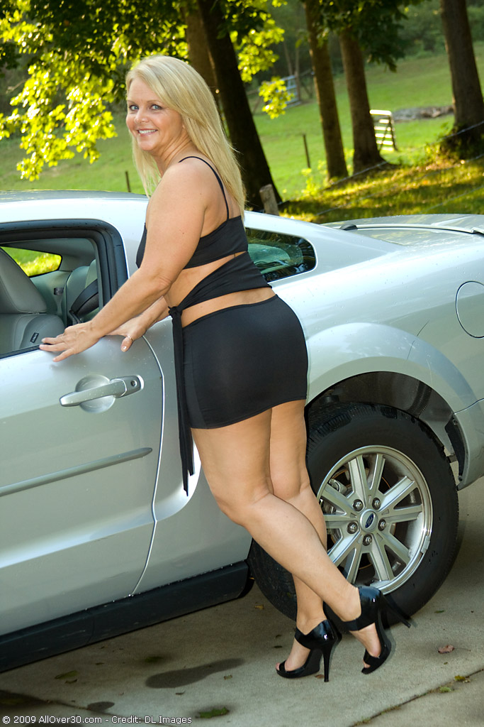 Older Honey and  Blond  Enormous Poses Her  Nude  Rump by My Sportscar