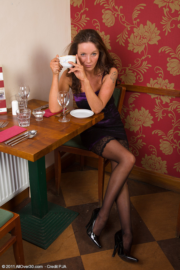 Hot 41 Year Old and Elegant Marlyn Loving a Spoon with Her Coffee