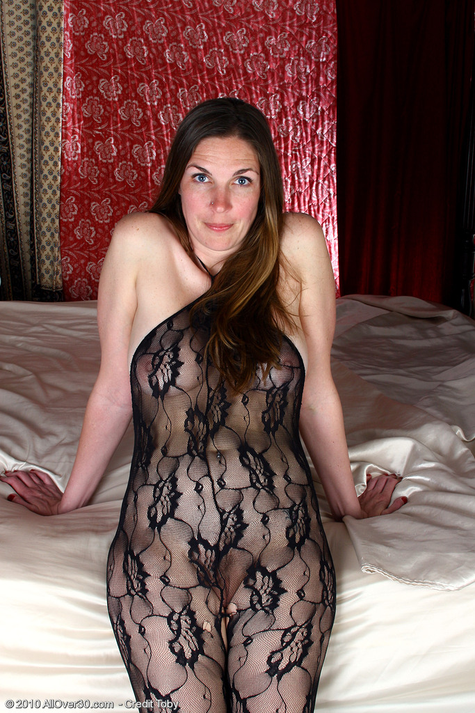 Hot  Brown Haired  Mom Phoebe in a Ebony Fishnet Gimp Outfit Shows  Butt