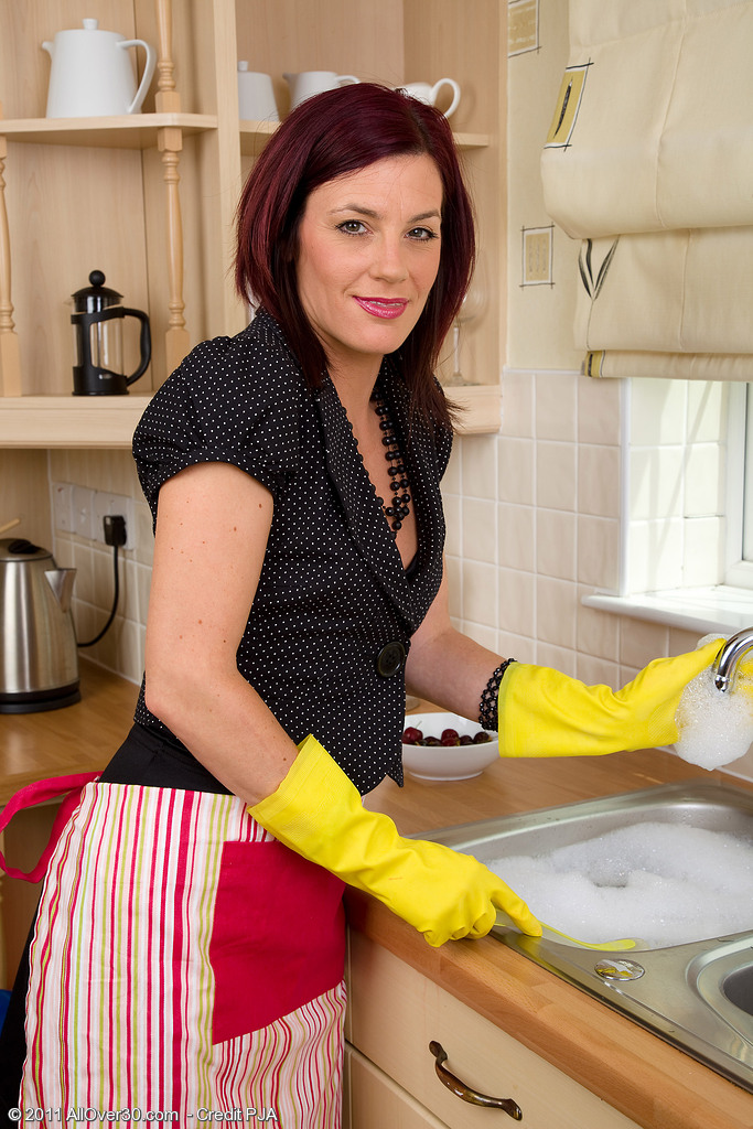Alluring Redheaded  Cougar Sofia Busy in the Kitchen with Her Cherries