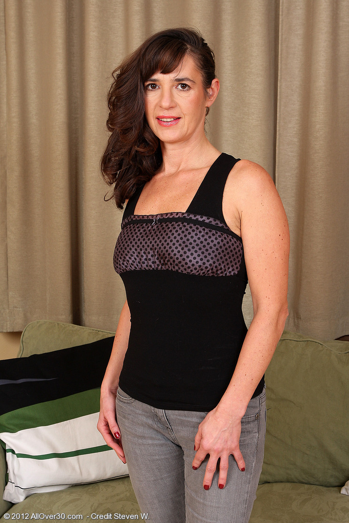 Brown Haired  Wife Suzie Glides off Her  Attire and  Opens Her Long Gams