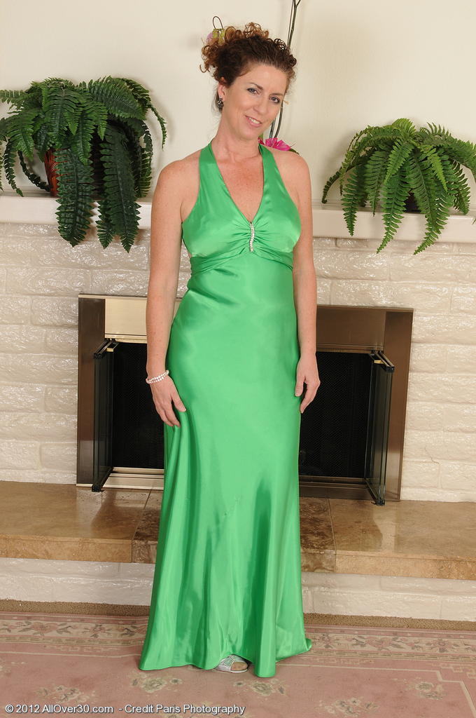 Elegant 46 Year Old Tammy Sue Glides out of Her Green Evening Gown