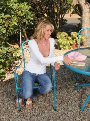Tall Slender  Blond Brynn Hunter Demonstrating off Her Full Body Tan Outdoors
