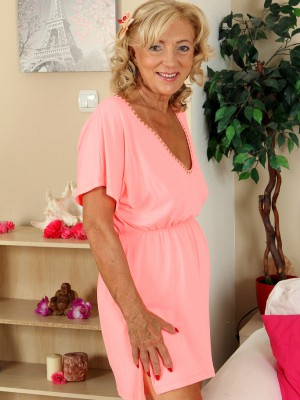 65 Year Old  Wifey Kamilla Putting on a Very Sexy Strip Show Here