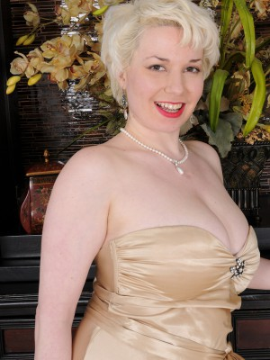 Blond Haired Plus Huge-chested Goldie Ray Slides off Her Gold Elegant Dress Inside Here
