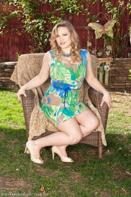 Big-boobed Victoria Tyler from  Milfs30 Stretches Her Gams Found on the Lawn Chair