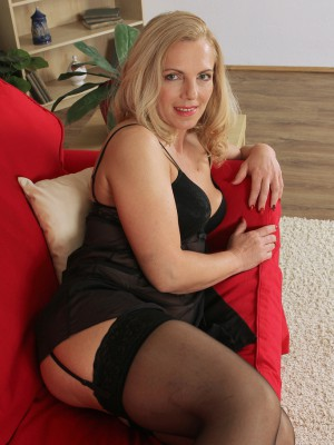 47 Year-old Britney from  Milfs30  Opens the Woman Stocking Covered Hips
