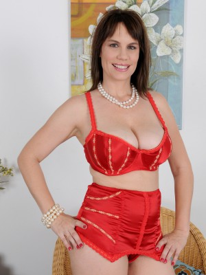 Hot and  Big Breasted Kelly Capone  Slides off Her Red Lace to Present Here