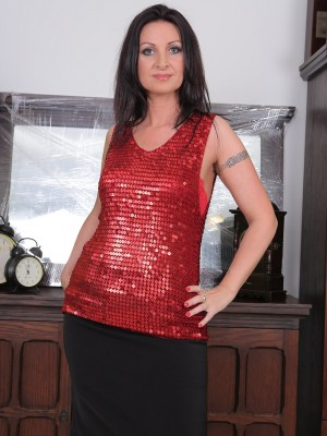 Alluring  Brown Haired Mummy Danni Stash Opens Up The Woman Stocking Clad Hips