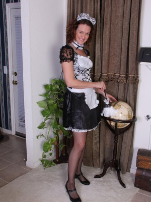 Roxanne Clemmens is a  Hot French Maid As She Slides from the girl Uniform