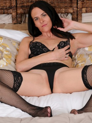 Passionate Maggie K Shows Those Long Remarkable Gams Inwards Her Ebony Fishnet Pantyhose