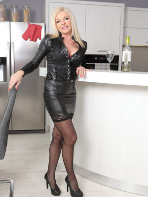 Blond  Cougar Carolina Carla Likes one glass of Wine Before Gliding out of the woman Tight Leather